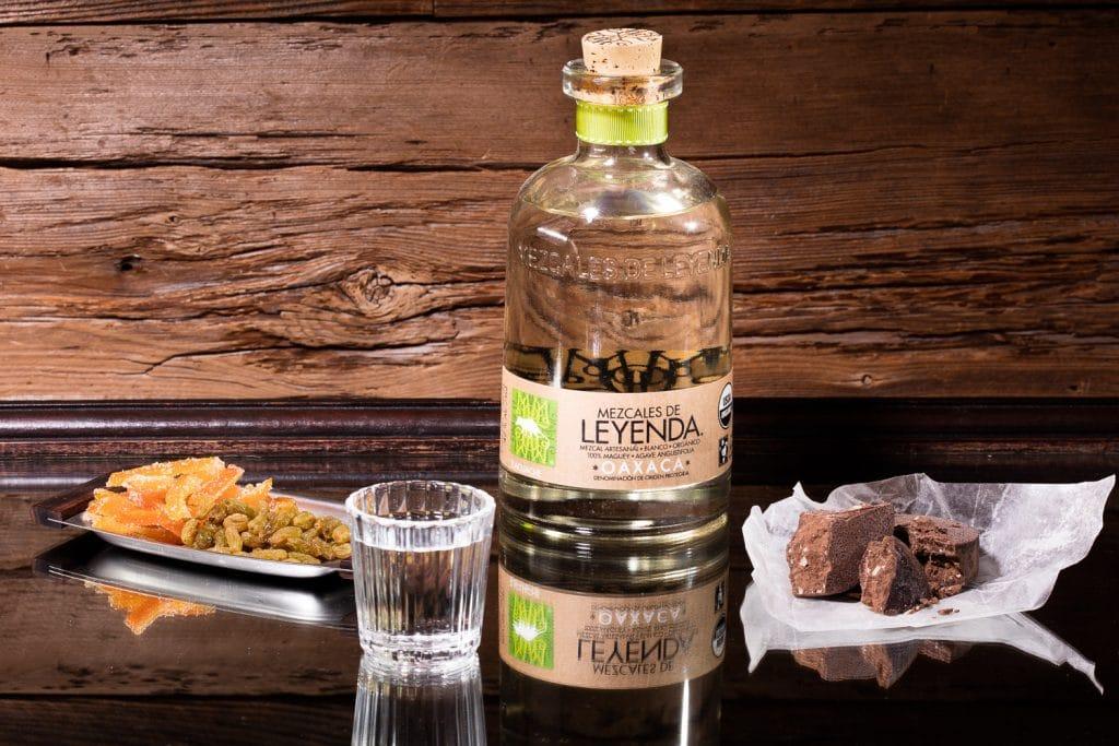 Product photography of a shot of mezcal and a bottle of Leyenda Mezcal.