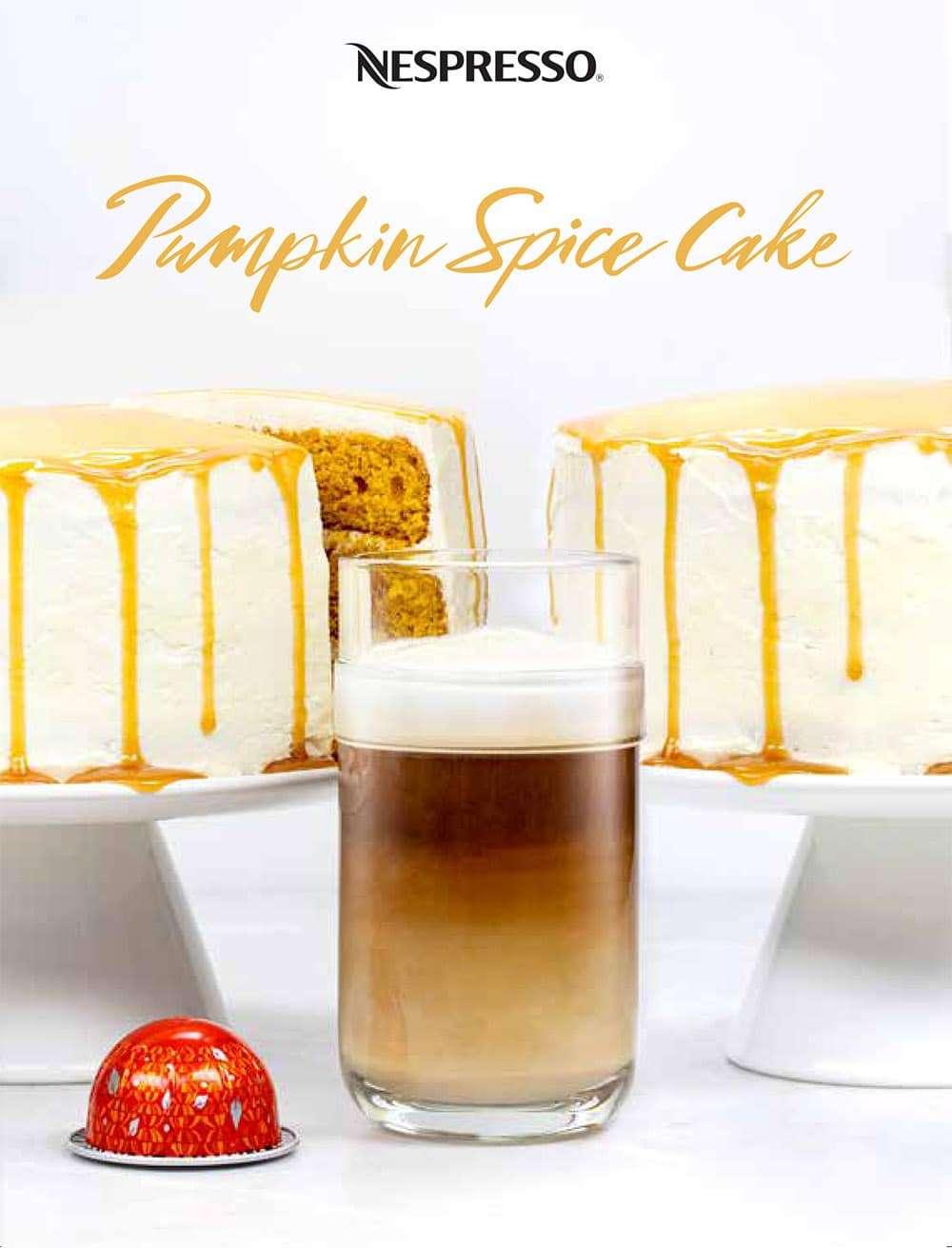 Pumpkin Spice latte in front of 2 Pumpkin spice cakes.