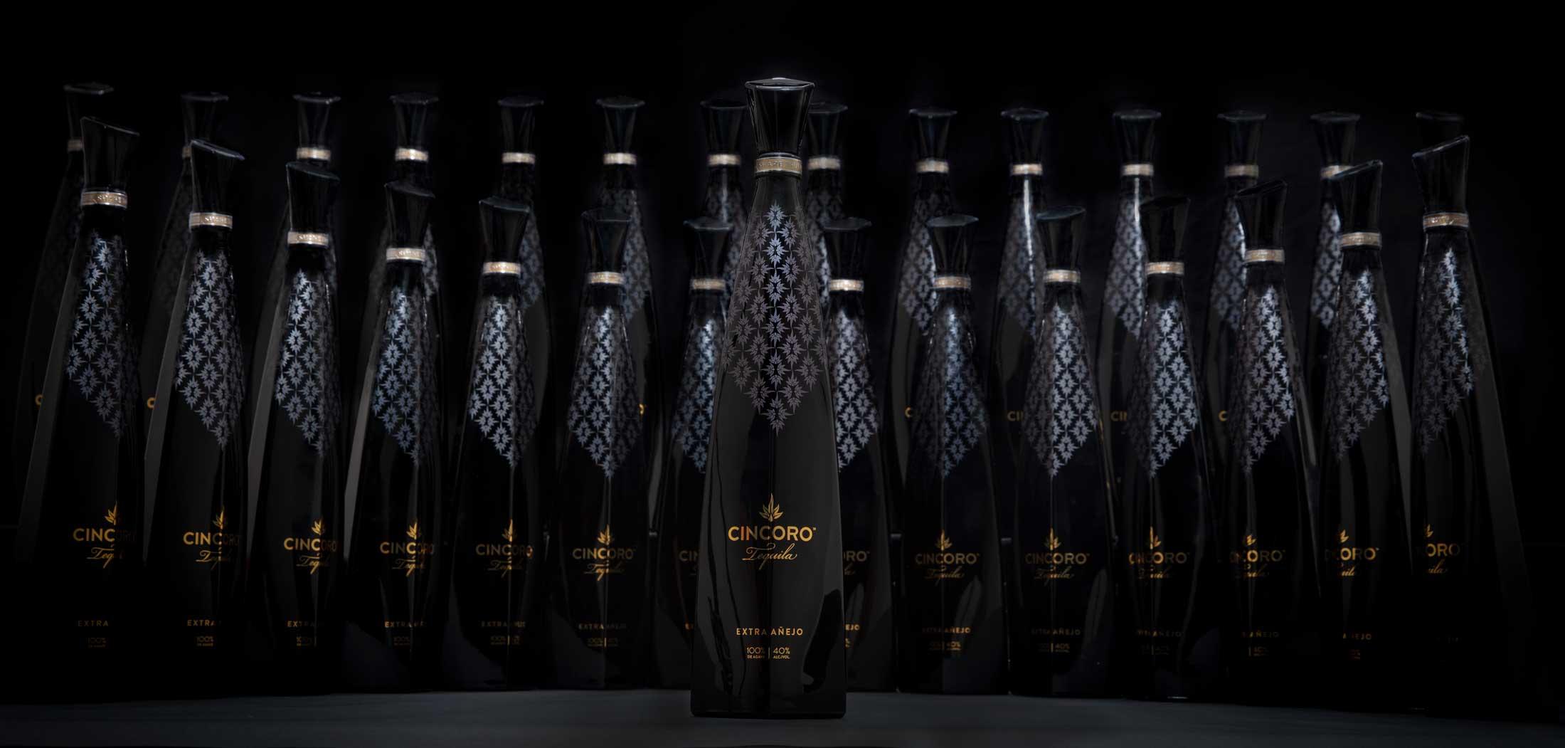 Bottle Photography for Cincoro Tequila shot on black of 29 bottles.