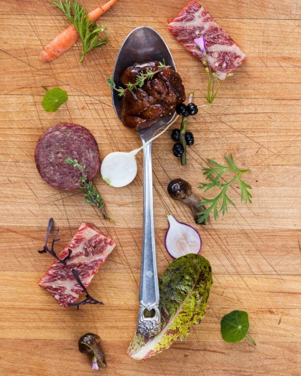 Chef Josh Hopkins Spoonful is surrounded by ingredients that were either foraged, farmed or grown.